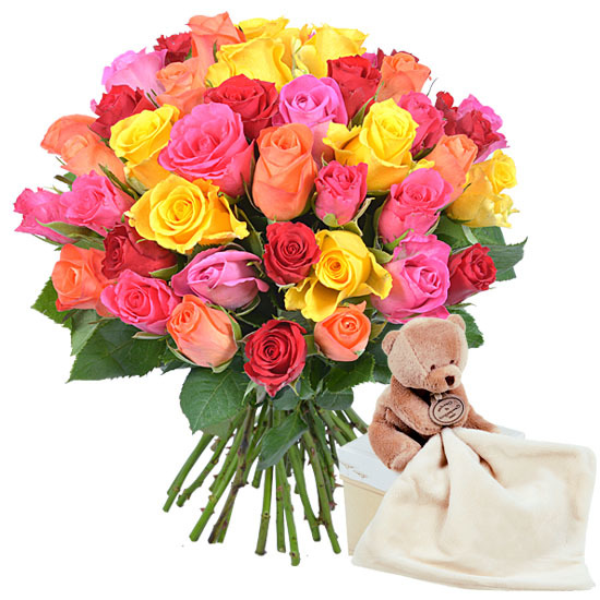 Colourful roses and cuddly teddy bear