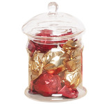 Glass sweet jar filled with praline chocolates