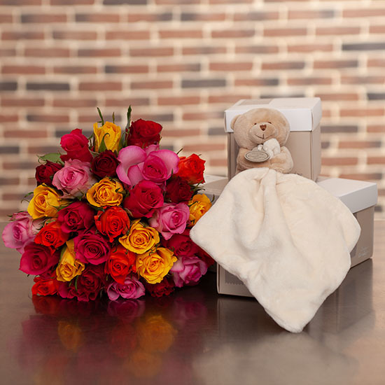 Multicoloured roses and cuddly teddy bear