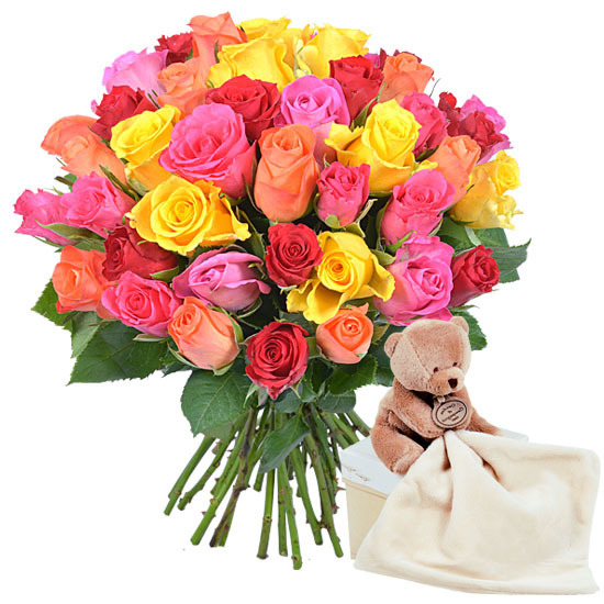 Multi-coloured roses and cuddly teddy bear
