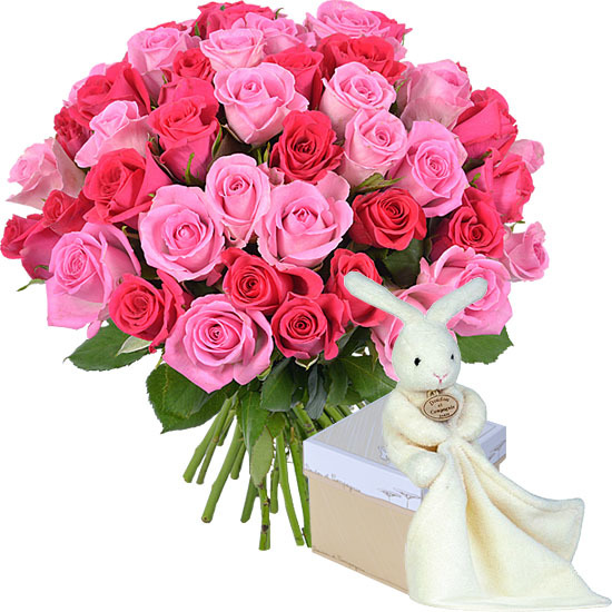 Romantic rose bouquet and cuddly rabbit